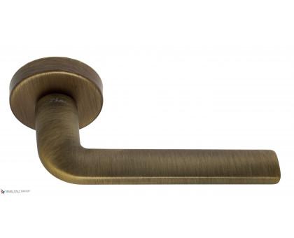 Дверная ручка Fratelli Cattini LINEA 7-BY на круглой розетке матовая бронза