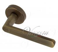 Дверная ручка Fratelli Cattini NEVADA 7-BY на круглой розетке матовая бронза